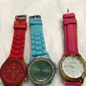 3 watches blue pink red